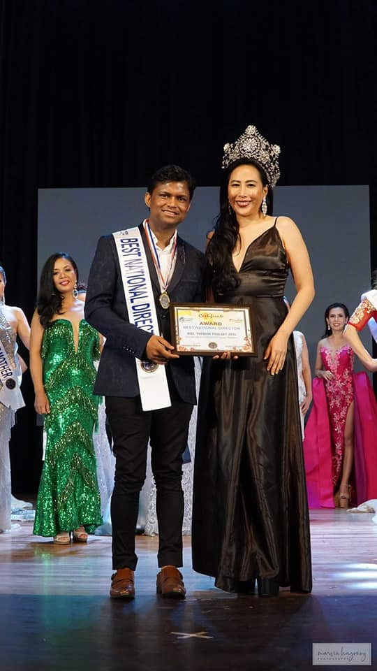 Sandeep Kumar while receiving the Best Pageant Director award at the grand coronation gala of Mrs. Tourism Universe pageant in Manila, Philippines.