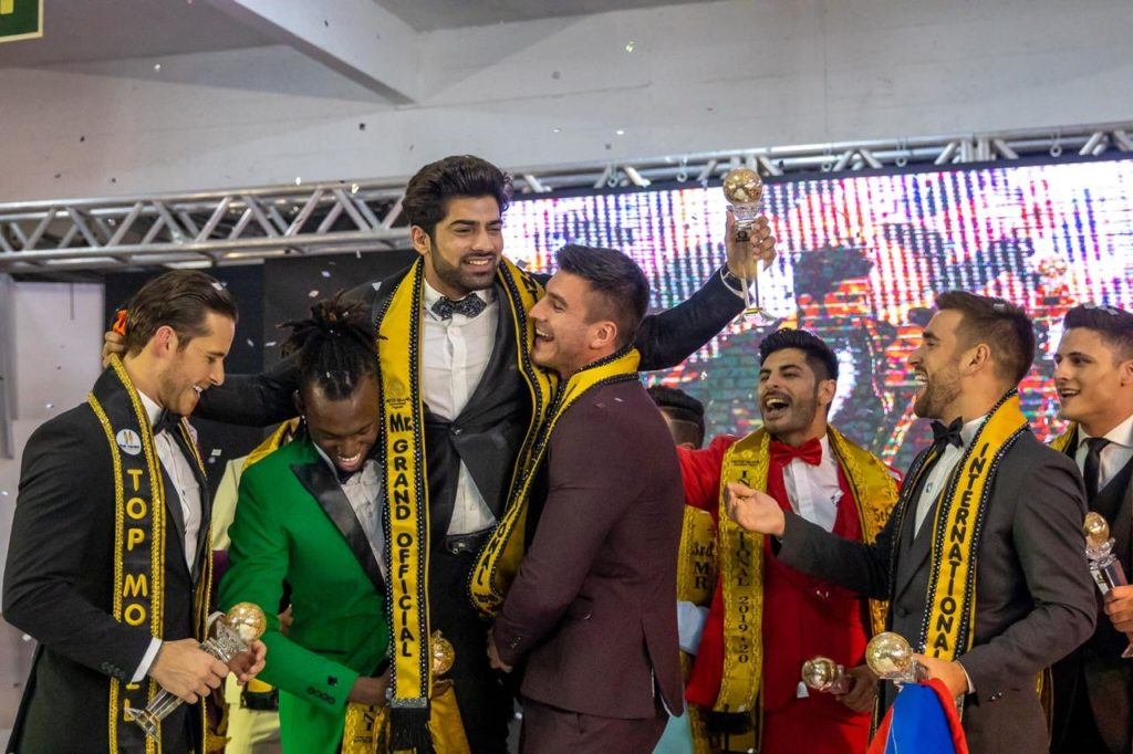 Ashwani Neeraj, the winner of Mr Grand International 2019 contest with his fellow contestants.